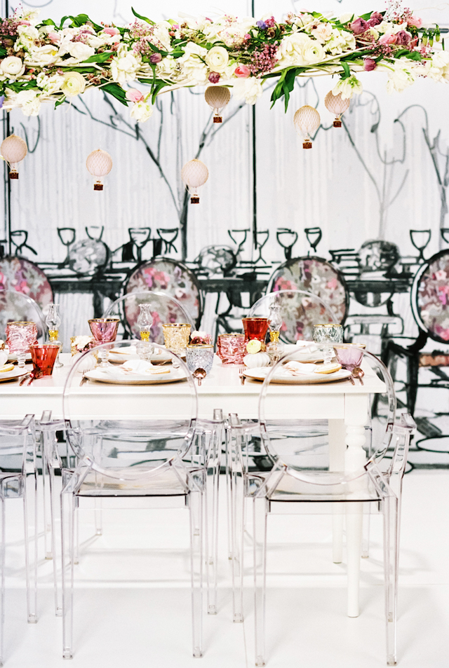 Artistic whimsical wedding tablescape with ghost chairs