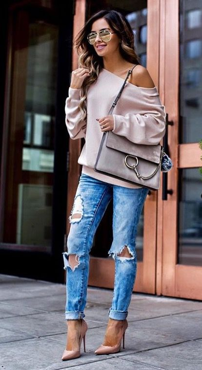 ripped blue jeans, a blush off the shoulder sweatshirt and blush heels