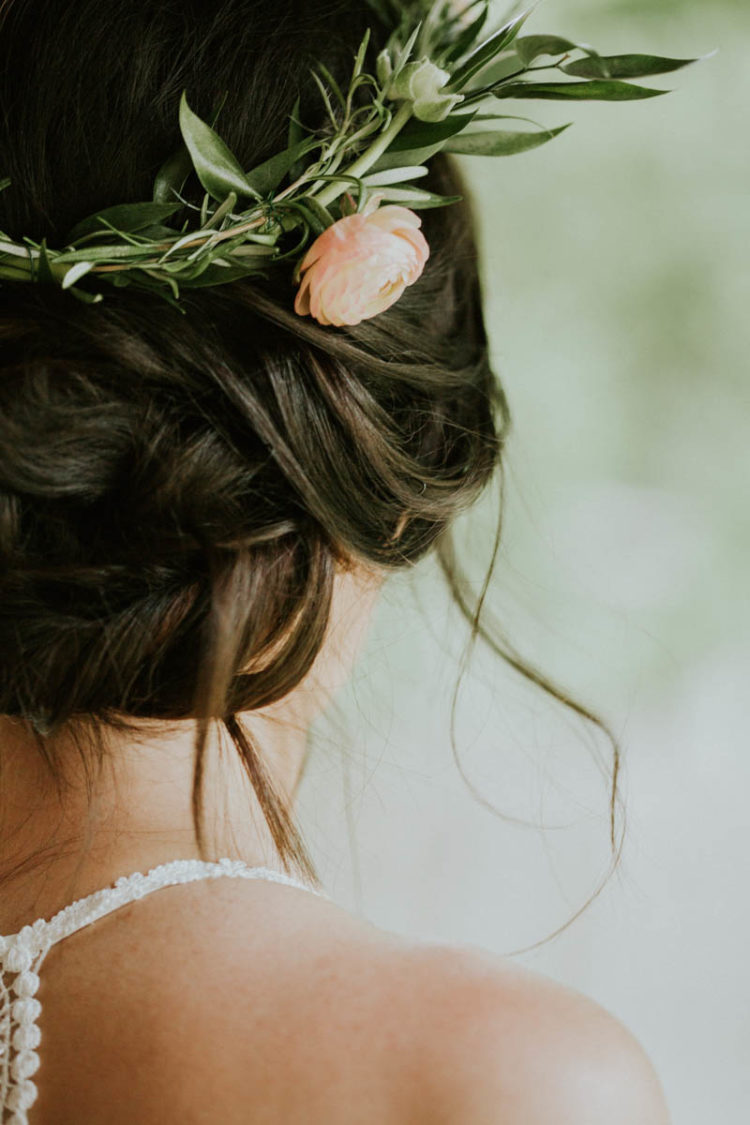 Her wedidng updo was accentuated with a floral crown