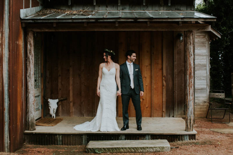 The groom was rocking a dark grey wedding suit with a neutral tie