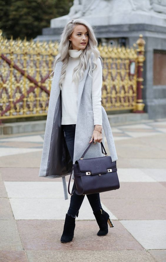 navy skinnies, a white sweater, a grey sleeveless coat, black suede booties and a black bag