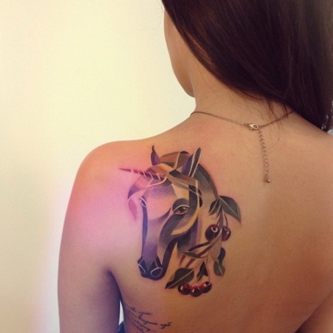 Unicorn and berries tattoo on the back