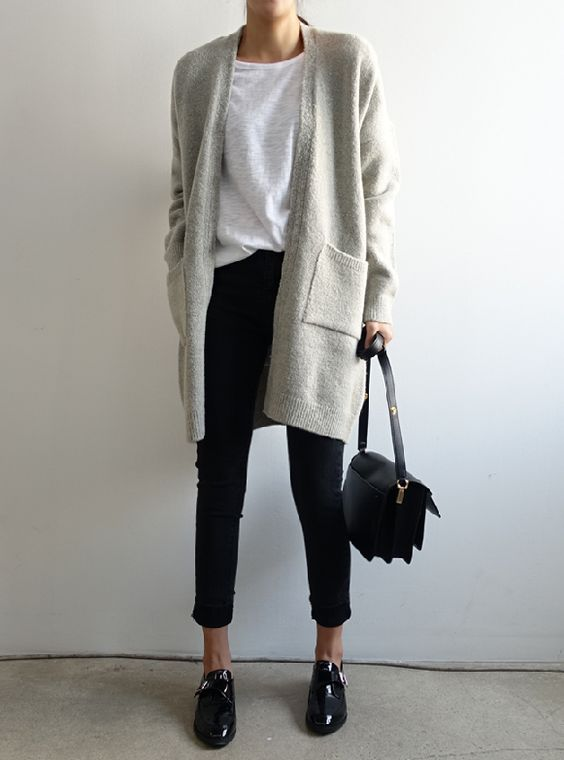 cropped black jeans, a neutral tee, a grey cardigan, black lacquered shoes and a black bag