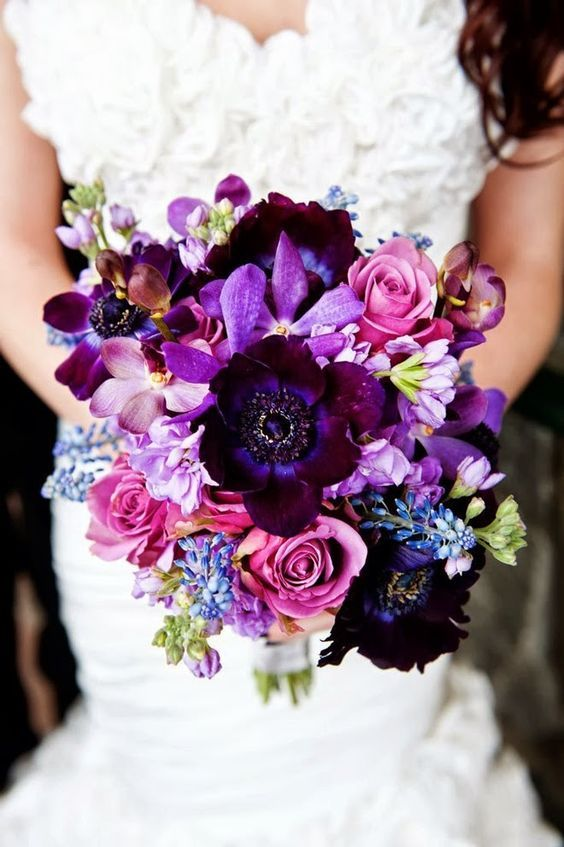 a gorgeous fall wedding bouquet with deep purple, lavender and lilac colored blooms