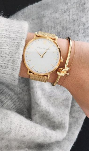 an elegant gold watch with gold bracelets for a super elegant and luxurious look
