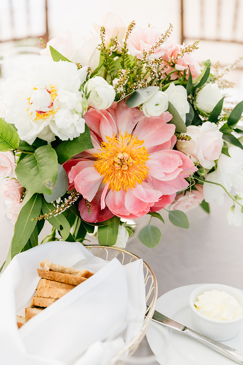 coral charm peony centerpieces - photo by Emily Wren Photography http://ruffledblog.com/bright-beautiful-summer-wedding-with-geometric-accents