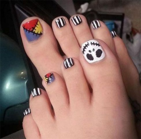 bold Frankenstein-inspired nails with striped black and white ones,a ghost face