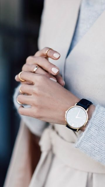 a gorgeous minimalist watch on a black leather band will fit many outfits