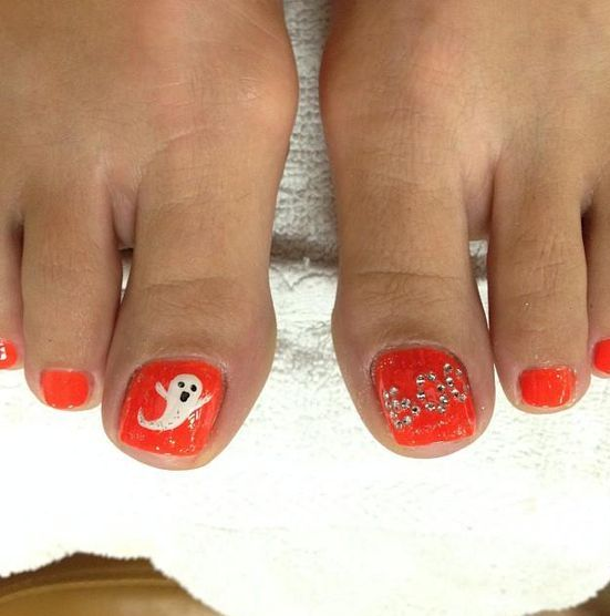orange toe nails with ghosts and BOO letters of rhinestones