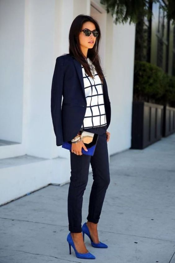 a navy suit with cropped pants, a window pane top, cobalt blue shoes and a clutch