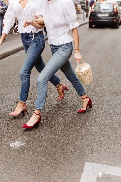 blue jeans, a white shirt with short sleeves and burgundy ankle strap velvet shoes