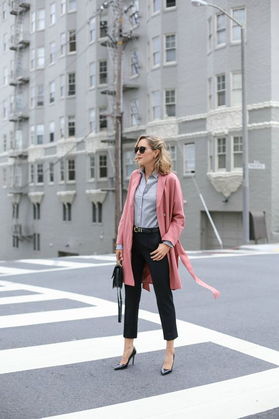 black cropped pants, black shoes, a grey shirt, a pink over the knee coat