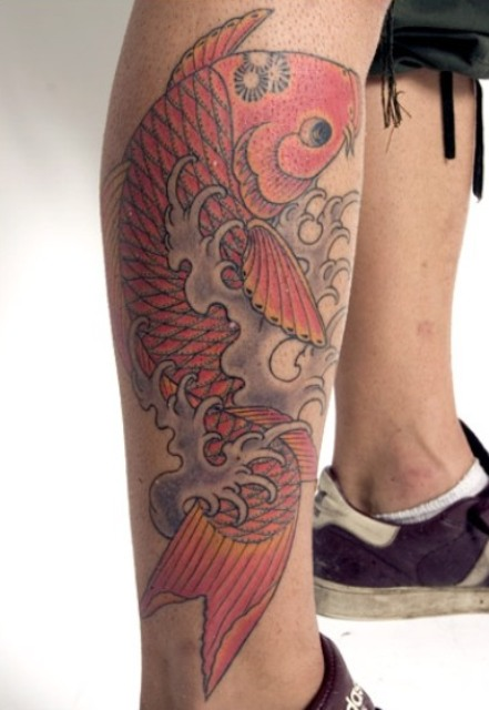 Carp fish tattoo on the leg