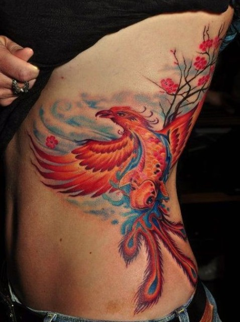 Phoenix and tree tattoo on the side