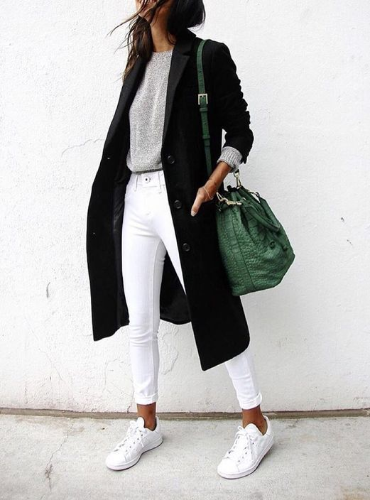 white cropped jeans, white chucks, a silver grey sweater, a black midi coat and a green bag