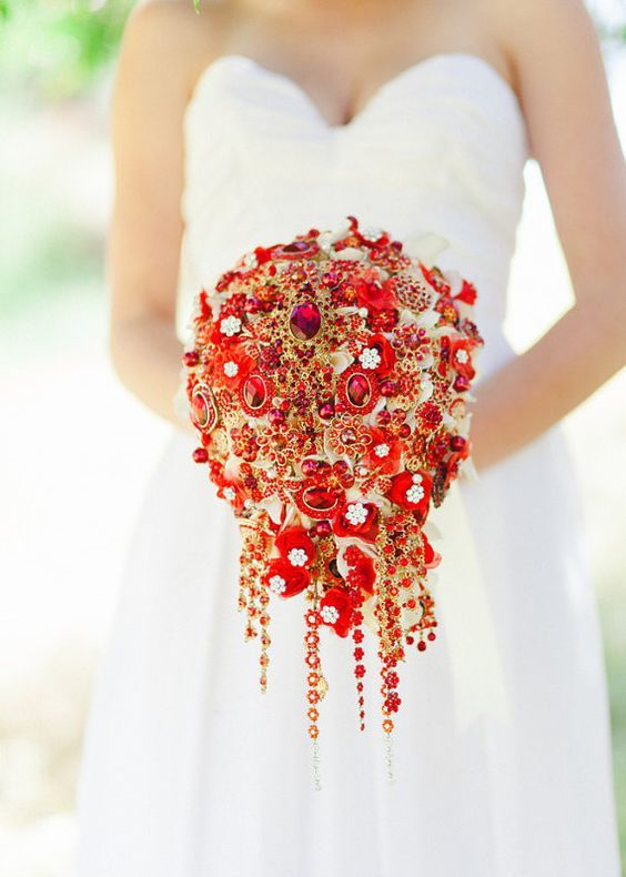 cascading red and gold brooch wedding bouquet won't wither during the day