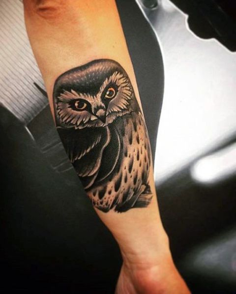Cute owl tattoo on the outer forearm