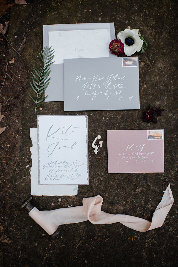The wedding stationery was done in light grey and blush, with calligraphy