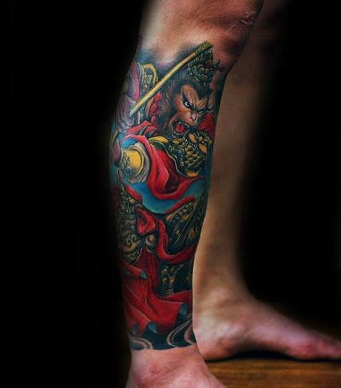 Colorful monkey king tattoo on the leg
