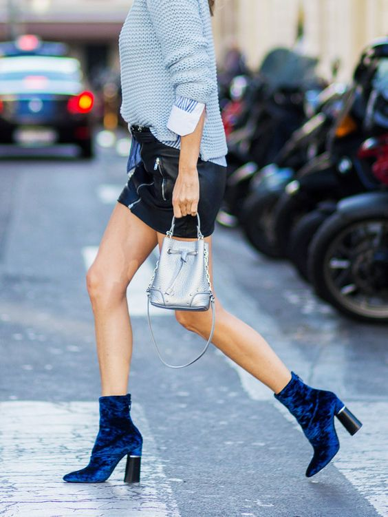 a leather mini, a chunky knit blue sweater, cobalt blue velvet booties and a small bag
