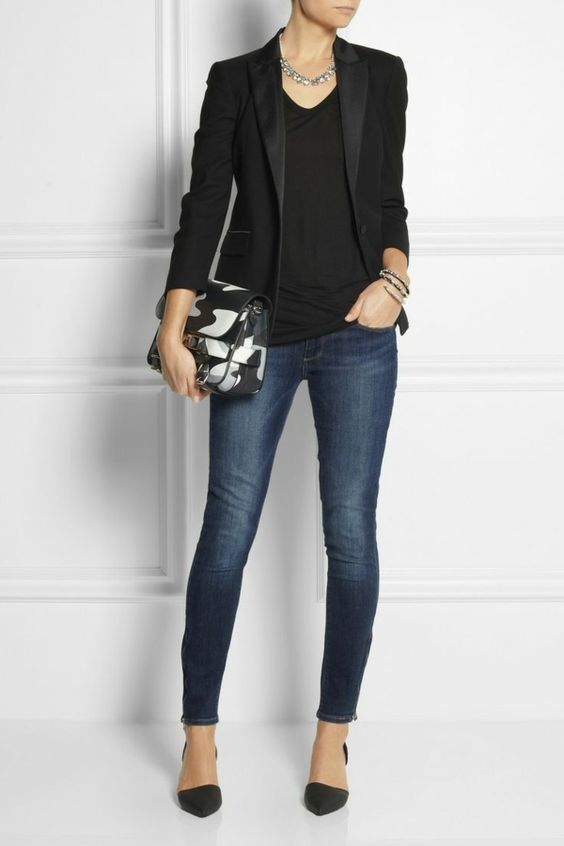 a chic look with navy skinnies, a black top, a black blazer and heels
