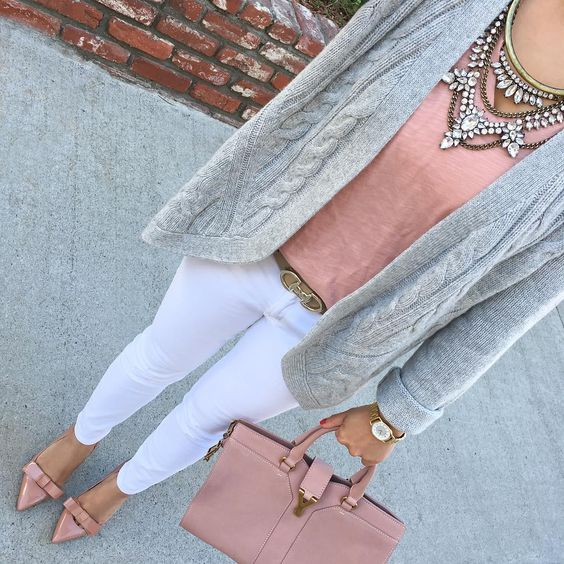 white jeans, a dusty pink top, matching shoes and a bag, a grey cable knit cardigan