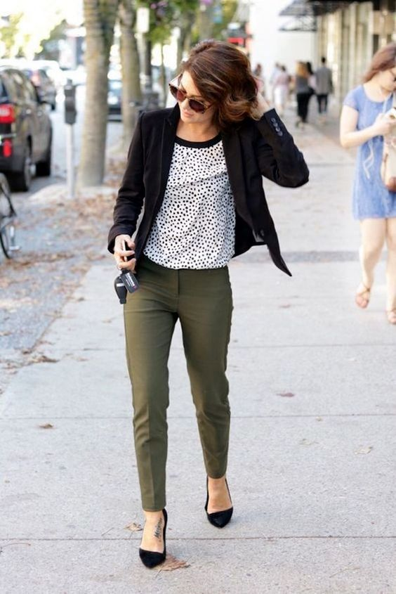olive green pants, a dalmatian print top, a black blazer and black heels is a non-boring look for fall