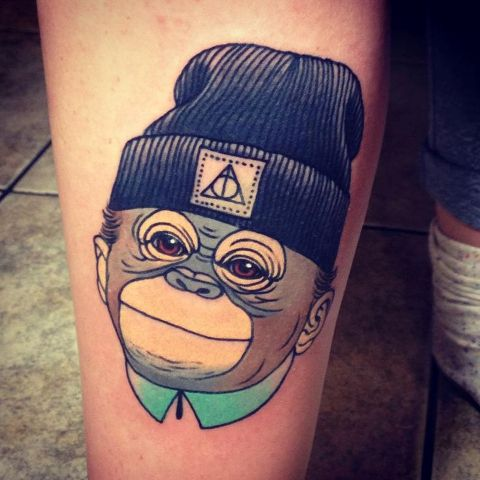 Cool monkey with a hat tattoo