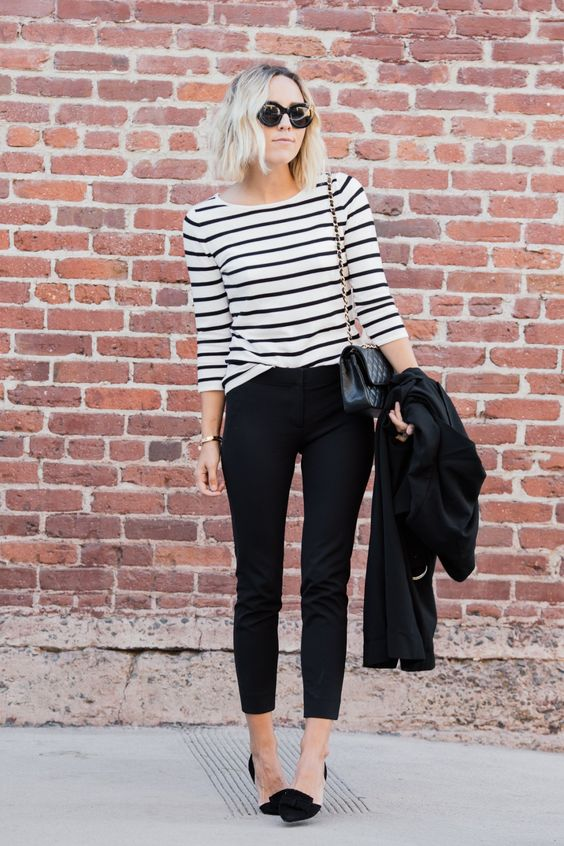 black cropped pants, a black and white striped top, black bow heels for a casual business look