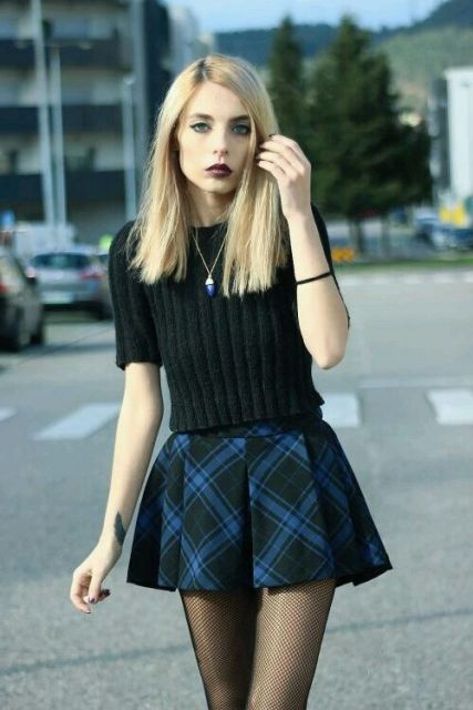 With black sweater and checked skirt