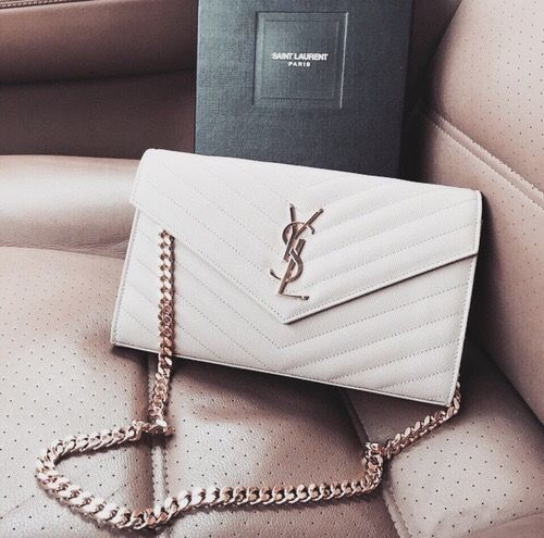a white clutch on a chain can be worn on the shoulder, too, which is a great idea