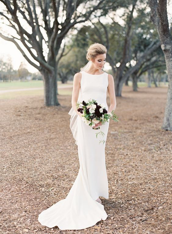 modern halter neckline wedding dress with a small train