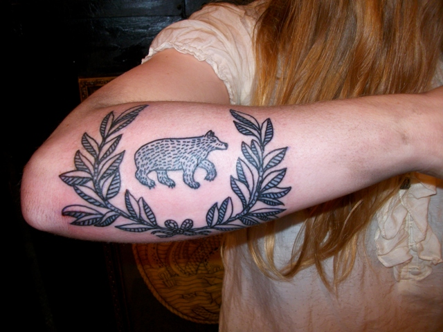 Black bear tattoo on the arm