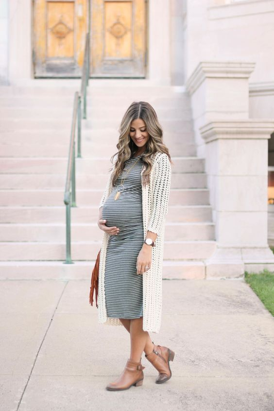 a striped grey dress, a white crochet long cardigan and brown booties