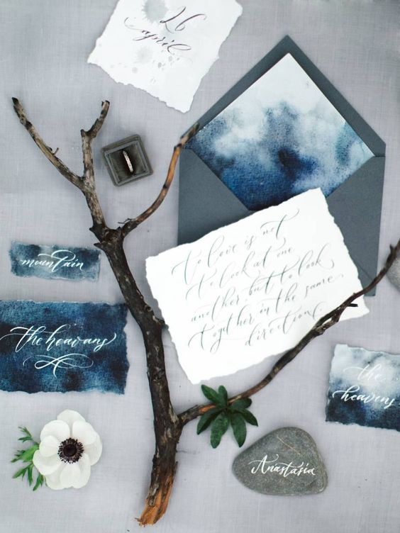 watercolor indigo wedding stationery with grey envelopes and a raw edge