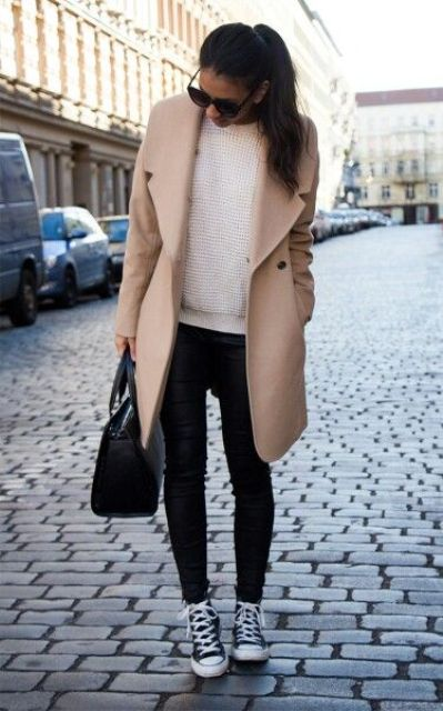 black leather pants, a white sweater, black chucks and a peachy knee coat