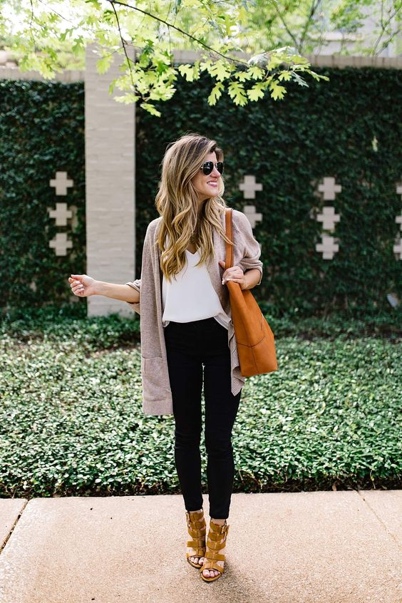 black cropped jeans, a white top, a neutral cardigan, amber shoes and an orange tote