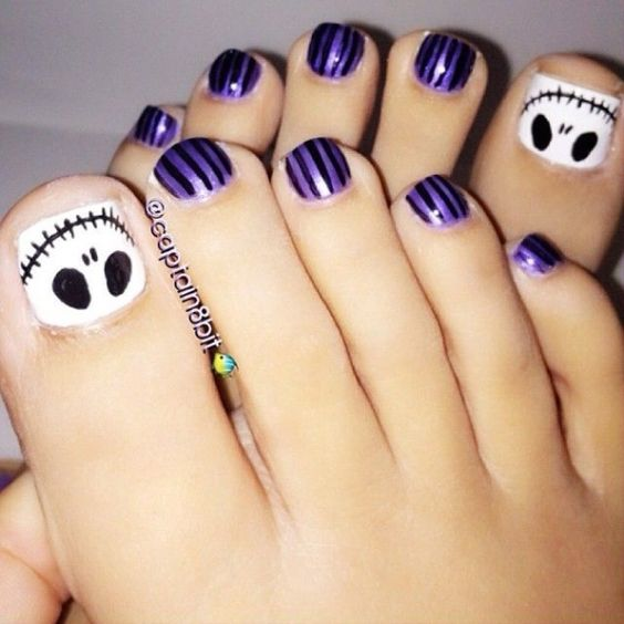 purple and black toe nails plus accent nails with a ghost face in black and white