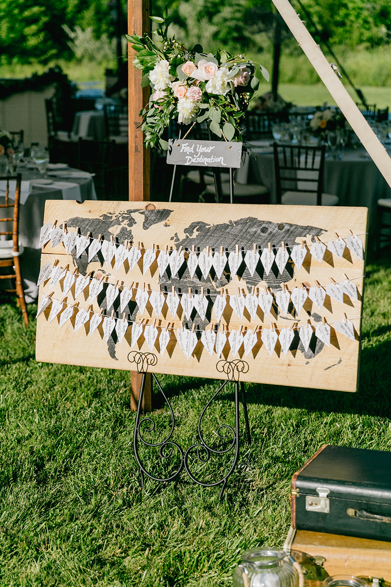 unique seating chart ideas - photo by Emily Wren Photography http://ruffledblog.com/bright-beautiful-summer-wedding-with-geometric-accents