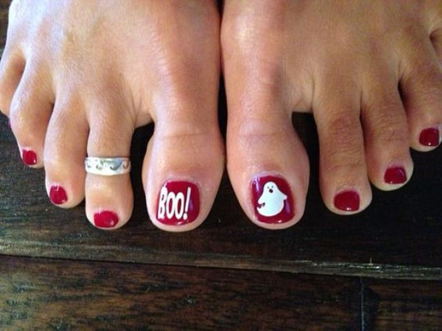 red nails with a white ghost and BOO accent nails