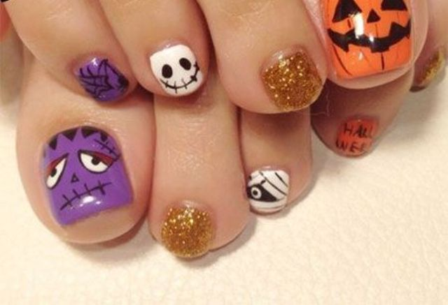 alluring toe nails with spooky faces, Frankestein in purple and Jack-o-lanterns