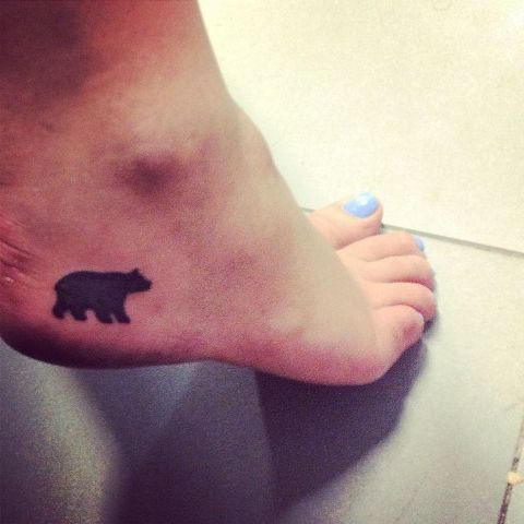 Small black tattoo on the foot