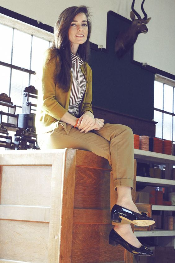 a black and white striped button-up shirt, a mustard cardigan, khaki trousers, low black heels