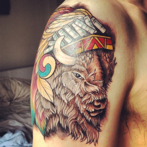 Colorful half-sleeve bison tattoo