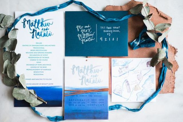 a teal envelope, watercolor indigo wedding invites