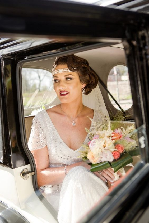 a deep V-neck wedding dress with heavy beading, cap sleeves, matching accessories and hair