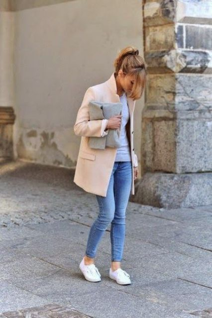 cropped jeans, a grey top, a peachy short coat, white sneakers