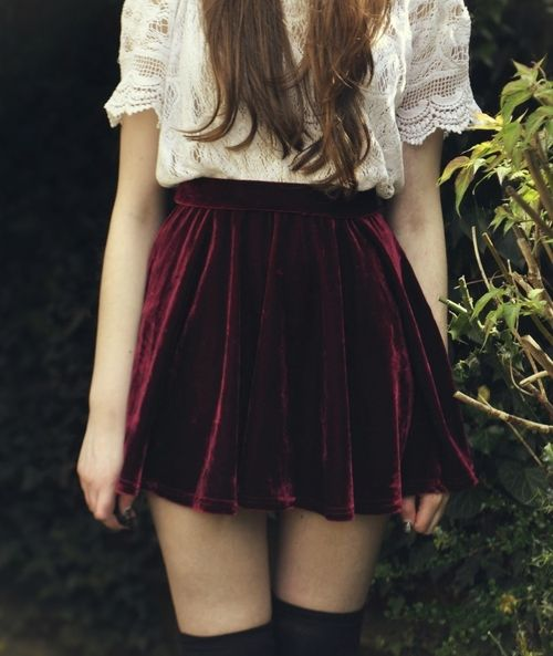 a white lace shirt, a maroon high waist velvet mini and black stockings