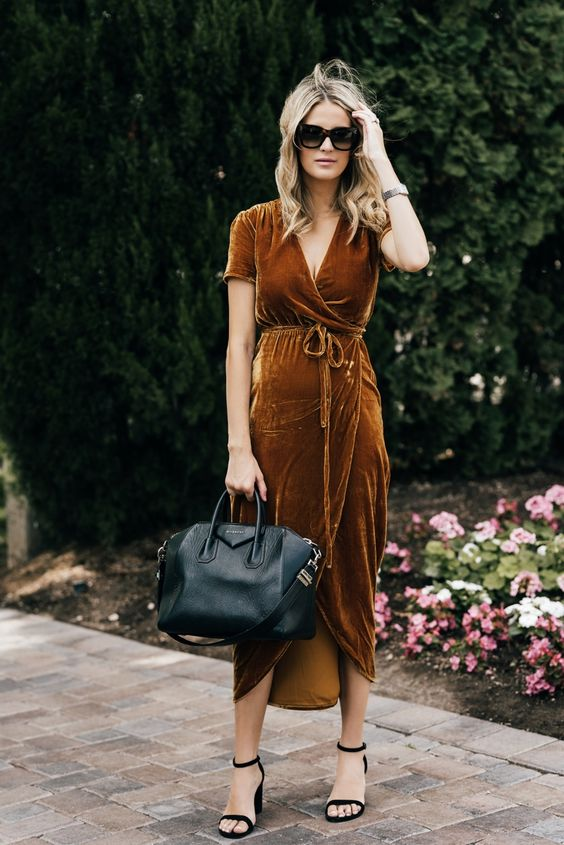 a mustard V-neckline high low dress with black heels