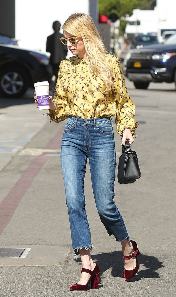 cropped blue jeans, a flowy yellow blouse with a floral print and burgundy velvet heels